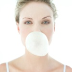 Young Woman Blowing a Chewing Gum Bubble